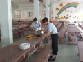 Co Chua and Co Kee giving a helping hand in preparing the food..jpg